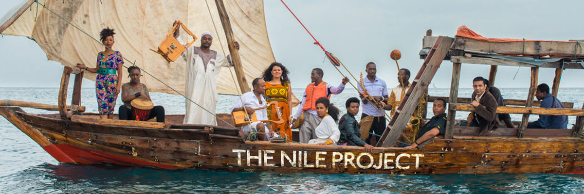 Nile Project musicians in a boat.