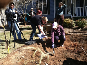 FOBC members and homeowners work on the first stage of the rain garden.