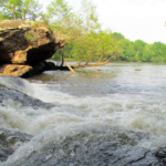 water flows over rocks at Lanier Falls in Raven Rock, North Carolina