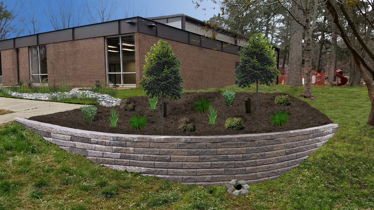 A 3D model of a bioretention on the edge of the Biltmore Hills park community center. The retention is composed of a brick wall barrier built onto the side of a small hill. The brick wall has is surrounding a large layer of soil.There are several plants including grasses and small trees planted in the soil. At the bottom of the brick wall is a small circular opening that allows water moving through the soil to exit the bioretention.